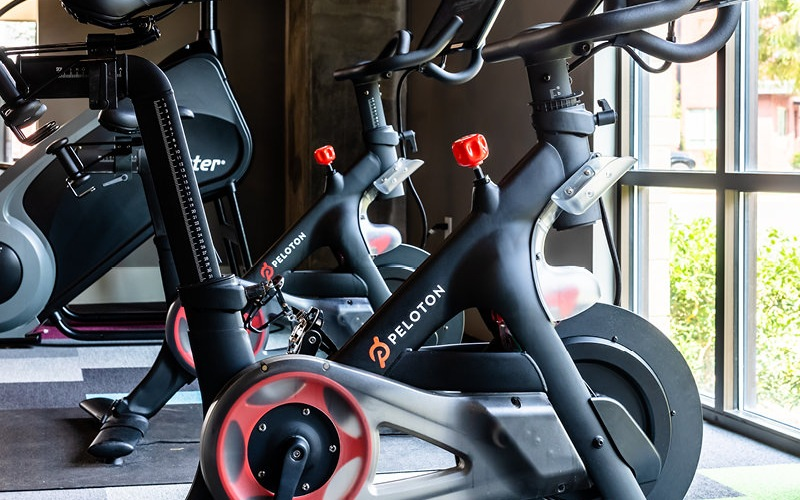 Peloton bike in the fitness center with floor-to-ceiling windows