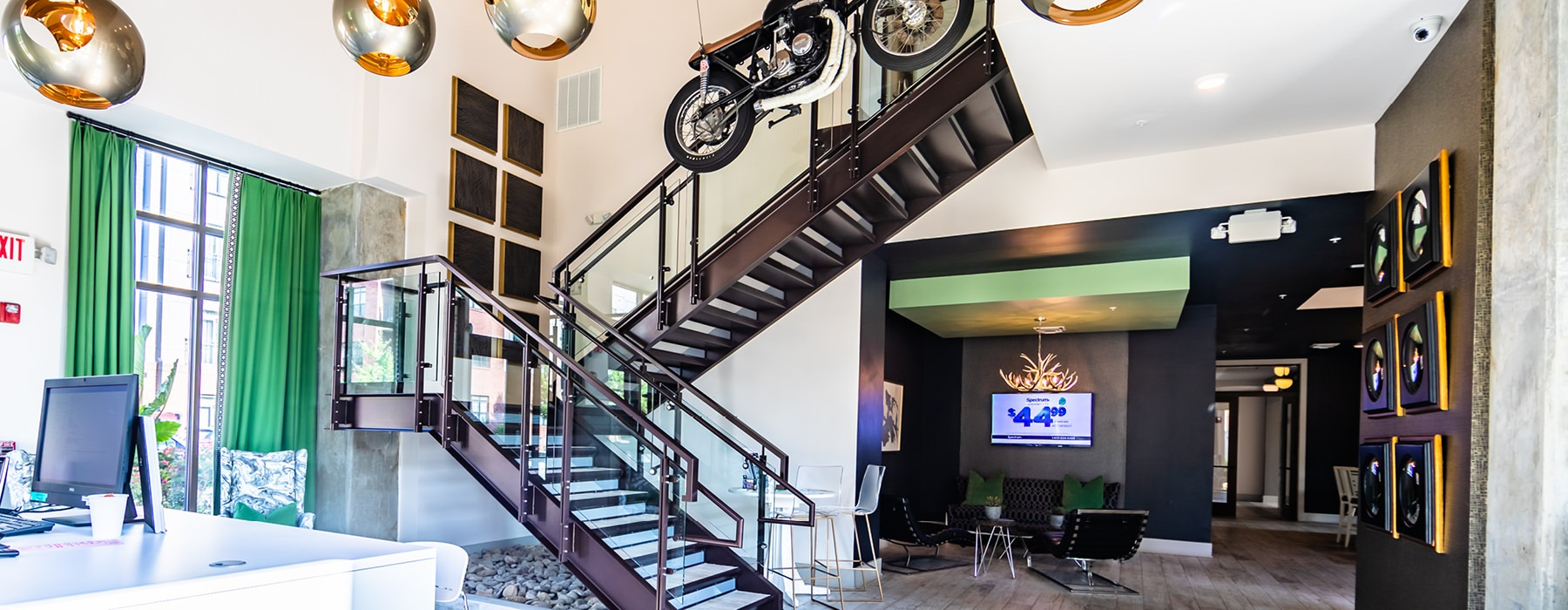 Lobby has industrial stairs and floor-to-ceiling windows