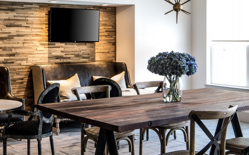 Clubhouse with wooden table and TVs
